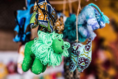 Colorful sewn fabric toys at market Stock Images
