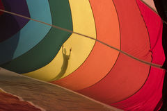 Colorful Shadow. Shadow of a boy seen through the colorful side of a hot air balloon- room to right for text Royalty Free Stock Photography
