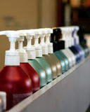 Colorful shampoo bottles. A closeup view of a row of colorful shampoo bottles at a beauty shop Royalty Free Stock Images