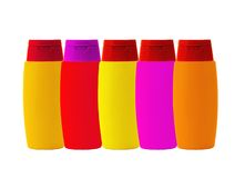 Colorful shampoo bottles on white Royalty Free Stock Photos