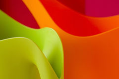 Colorful shapes. In plastic vases Stock Photos