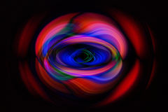 Colorful shapes on dark background. Abstract background (on black) with roughly circular red bands enclosing distorted blue shapes overlapping to produce touches Royalty Free Stock Image