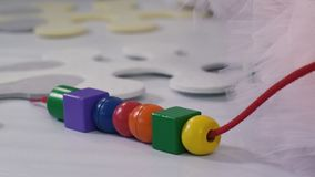 Colorful shapes on a string stock video footage