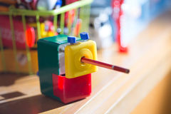 Colorful sharpener pencil Stock Images