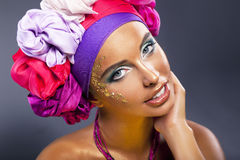 Colorful shawl. Pretty woman face - bright make up Stock Image