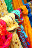 Colorful shawls. Display of colorful shawls in a shop royalty free stock images