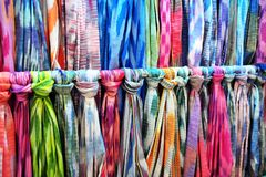 Colorful shawls on flea market royalty free stock photography