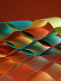 Colorful sheets paper with mirror reflexions. Background macro image of colorful origami pattern made of curved sheets of paper, with mirror reflexion, on orange Stock Image
