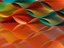 Colorful sheets paper with mirror reflexions. Background macro image of colorful origami pattern made of curved sheets of paper, with mirror reflexion, on orange Royalty Free Stock Photo