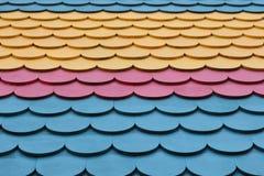 Colorful shingle pattern. Pink, blue, and yellow colorful shingle pattern stock photo