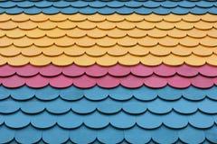 Colorful shingle pattern. Pink, blue, and yellow colorful shingle pattern stock photography
