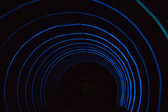 Colorful shining circle tunnel lined background Stock Images