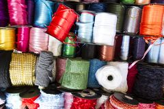 Colorful shiny fabric strings in Flohmarkt im mauerpark ,Berlin. Germany royalty free stock photos
