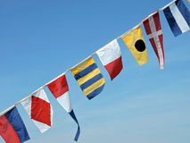 Colorful ship flags Stock Image