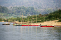 Colorful ships at the banks of the Mekong River. In Lao Stock Image