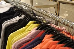 Colorful shirt in row in shop Royalty Free Stock Photo
