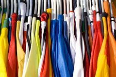 Colorful Shirts. A rack of colorful shirts (Jerseys) for sale at an open market Royalty Free Stock Images