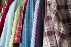 Colorful Shirts. Many colorful shirts hanging in a closet Royalty Free Stock Photography