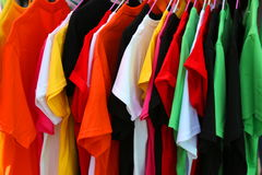 Colorful shirts. On the hangers Royalty Free Stock Photos