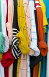 Colorful shirts on hangers Stock Photos