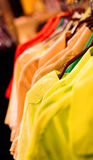Colorful shirts on hangers Royalty Free Stock Photo