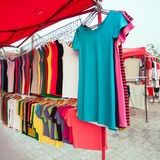 Colorful shirts for sale at market. A lot of colorful shirts for sale at market Royalty Free Stock Photo