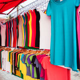 Colorful shirts for sale at market Stock Photography