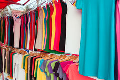 Colorful shirts for sale at market Royalty Free Stock Images