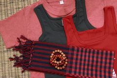 Colorful shirts and traditional khmer scarfs and beads Stock Images