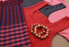Colorful shirts and traditional khmer scarfs and beads Stock Photography