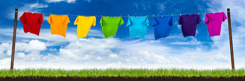 Colorful shirts on washing lin Stock Photos