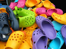 Colorful shoes. Lots of colourful summer sandals on a market outdoors Stock Photography