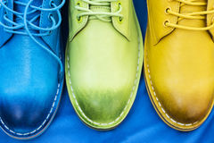 Colorful shoes on a blue background Royalty Free Stock Images