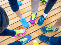 Colorful shoes on feet point together Royalty Free Stock Images