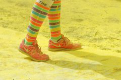 The colorful shoes and legs of one of the officials Royalty Free Stock Photography