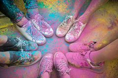 The colorful shoes and legs of teenagers at color run event.  Royalty Free Stock Photography