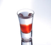 Colorful shooter with reflection. Colorful layered shot isolated on white gray gradient background with reflection. Alcohol shooter Royalty Free Stock Photos