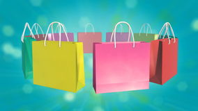 Colorful Shopping Bag on twinkle background. Loop able Colorful Shopping Bag rotate on twinkle background stock footage