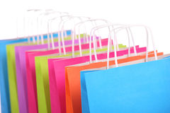 Colorful Shopping bags. A picture of a row of colorful shopping bags over white background royalty free stock image