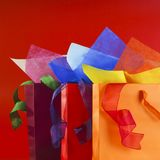 Colorful shopping bags with colorful wrapping papers and ribbons stock photography