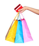 Colorful Shopping Bags and Credit Card in Female Hand isolated Royalty Free Stock Image