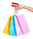 Colorful Shopping Bags and Credit Card in Female Hand isolated Royalty Free Stock Photography