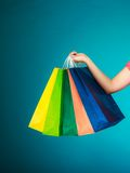 Colorful shopping bags in female hand. Sale retail stock image