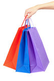 Colorful shopping bags in hand isolated. Colorful shopping bags set in woman's hand isolated on white Royalty Free Stock Photography