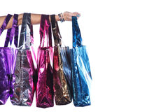 Colorful shopping bags with hand Stock Image