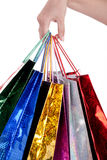 Colorful shopping bags holding by human hand Stock Photo
