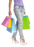 Colorful Shopping Bags and Sexy Female Legs isolated Stock Photography