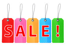 Colorful shopping tags printed with `sale!` text. Stock Photo