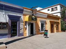 Colorful shops in small town Mexico. Colorful art shops in small town Mexico waiting for American tourists for business Royalty Free Stock Images