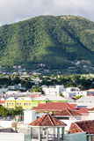 Colorful Shops Under Green Hills on St Kitts Stock Photography